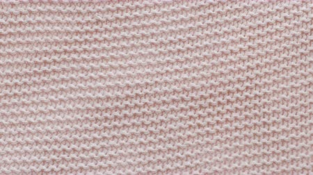 kötés : Pink texture of the knitted fabric. Stock mozgókép