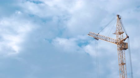 аренда : Construction of a multi-storey building. House and construction crane on sky background. Стоковые видеозаписи