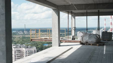 unfinished : View of the city from an unfinished multi-storey building.