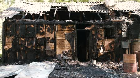 charred : Burned down private wooden house.