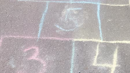 Hopscotch game on asphalt in Park. Painted with colorful chalks.