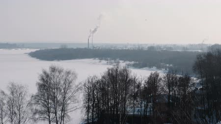 Winter city landscape with Smoking factory chimneys. Stok Video