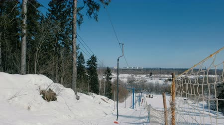 Ski lift in mountain in city park.
