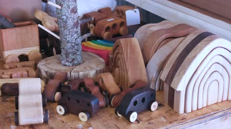 Wooden toys on the table in workshop.