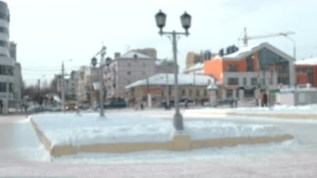 View of the crossroad in the city with cars and pedestrians. Winter view to the city. Blur.