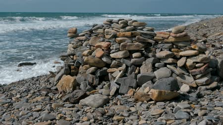 stacked rock : Wall of stones on the sea shore beach.