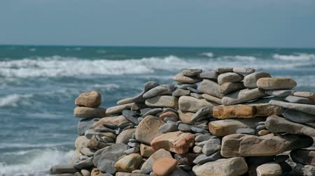 Wall of stones on the sea shore beach.