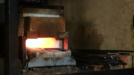 marreta : Making the sword out of metal at the forge.Hot metal billets in the furnace.