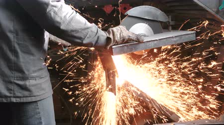Cutting of metal. Closeup men cut metal with a circular saw. Sparks fly to the side. Wideo