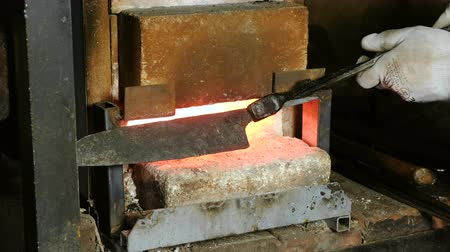 сварщик : Making the knife out of metal at the forge. Heating of metal billets in the furnace.