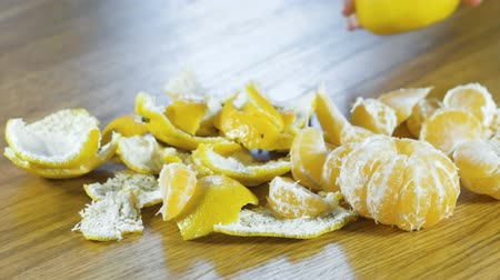 clear the table : Tangerines and peel on the kitchen table. Close-up view.