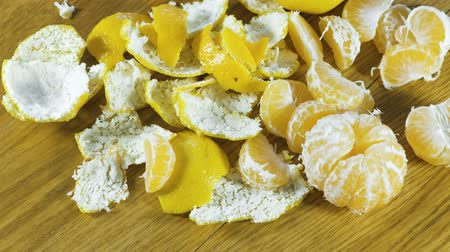 mandarinka : Tangerines and peel on the kitchen table. Close-up view.