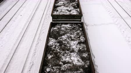 kaplanmış : Freight vagons with metal shavings among rails at the railway station in the winter.