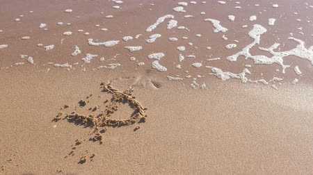 промывали : Dollar sign written in the sea sand. Waves washed away the inscription.