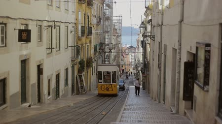 lisboa : LISBON, PORTUGAL - SEP 15, 2015: Famous retro designed funicular in the Old Town street of Lisbon, Portugal. Professional shot on DSLR fith high dynamic range. You can use it e.g in your video, documentalistic, reporting, presentation, music video.