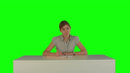 vysoká klíč : Young girl sitting in classroom at lecture and listening teacher on a Green Screen, Chroma Key. Professional shot on BMCC RAW with high dynamic range. You can use it e.g in your commercial video, business video, office theme. Dostupné videozáznamy