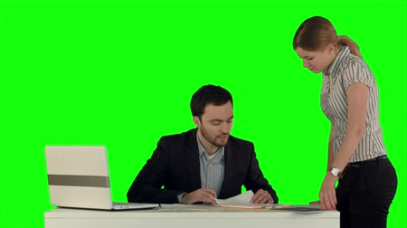 irodai dolgozó : Angry boss with female worker in office on a Green Screen, Chroma Key. Professional shot on BMCC RAW with high dynamic range. You can use it e.g in your commercial video, business video, office theme. Stock mozgókép