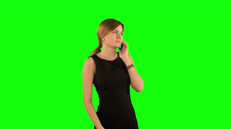 vysoká klíč : Portrait of happy young Woman Talking On Mobile Phone on a Green Screen, Chroma Key. Professional shot on BMCC RAW with high dynamic range. You can use it e.g in your commercial video, business video, office theme.
