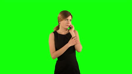 vysoká klíč : Portrait of smiling business woman phone talking on a Green Screen, Chroma Key. Professional shot on BMCC RAW with high dynamic range. You can use it e.g in your commercial video, business video, office theme. Dostupné videozáznamy