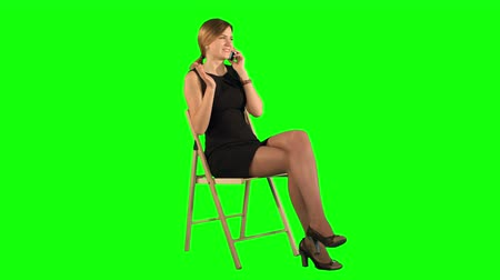 klucz : Young Business Woman Using Telephone on a Green Screen, Chroma Key. Professional shot on BMCC RAW with high dynamic range. You can use it e.g in your commercial video, business video, office theme.