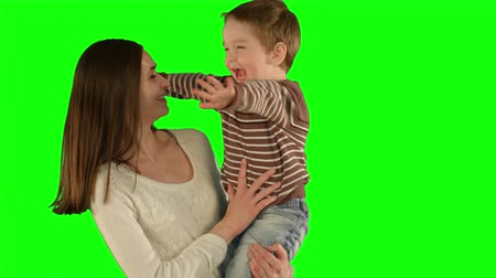 vysoká klíč : happy family having fun.  on a Green Screen, Chroma Key. Professional shot on BMCC RAW with high dynamic range. You can use it e.g in your commercial video, family video, music video.