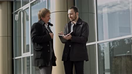 profi : Two businessmen discussing something. Professional shot on BMCC with high dynamic range. You can use it e.g in your commercial video, business or office video, reporting, presentation, music video, clips.