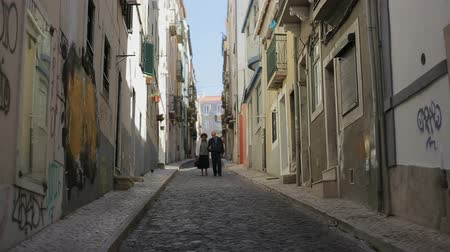 sortudo : Together in an old street, old couple walkingProfessional shot on DSLR with high dynamic range. You can use it e.g in your video, documentalistic, reporting, presentation, music video, commercial video.