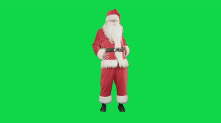 santa : Happy Christmas Santa Claus having fun and dancing on a Green Screen, Chroma Key. Professional shot on BMCC RAW with high dynamic range. You can use it e.g in your commercial video, christmas holiday video, santa claus theme, dance party. Stock Footage