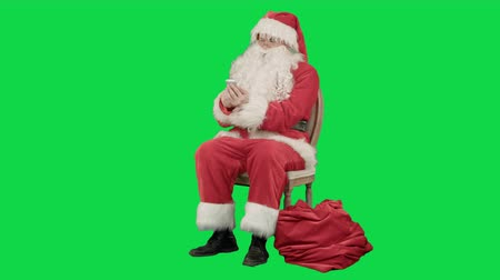 call out : Santa laughing out loud as he talks on his cell phone on a Green Screen, Chroma Key. Professional shot on BMCC RAW with high dynamic range. You can use it e.g in your commercial video, christmas holiday video, santa claus theme, dance party. Stock Footage