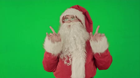 santa : Happy dancing Santa Claus on a Green Screen, Chroma Key. Professional shot on BMCC RAW with high dynamic range. You can use it e.g in your commercial video, christmas holiday video, santa claus theme, dance party. Stock Footage