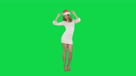 klucz : Christmas girl in santa hat dancing happy laughing having fun on a Green Screen, Chroma Key. Professional shot on BMCC RAW with high dynamic range. You can use it e.g in your commercial video, christmas holiday video, santa claus theme, dance party.