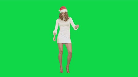 ключ : Christmas Holidays young attractive woman dancing on a Green Screen, Chroma Key. Professional shot on BMCC RAW with high dynamic range. You can use it e.g in your commercial video, christmas holiday video, santa claus theme, dance party.