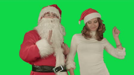 senhora : Santa claus with beautiful dancing girl on a Green Screen, Chroma Key. Professional shot on BMCC RAW with high dynamic range. You can use it e.g in your commercial video, christmas holiday video, santa claus theme, dance party.