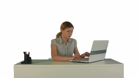 table top shot : Businesswoman working on laptop on white background isolated. Professional shot on BMCC RAW with high dynamic range. You can use it e.g in your commercial video, business video, office theme.