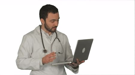 в чате : Doctor Having Video Conference on laptop With Patient on white background. Professional shot on BMCC RAW fith high dynamic range. You can use it e.g in your commercial video, commercial video, medical ,video about clinic, doctor, health, hospital, medicin