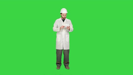 pager : Healthcare professional, doctor, nurse, dentist, researcher, physician assistant, reading text sms, message on cell phone on a Green Screen, Chroma Key. Stock Footage