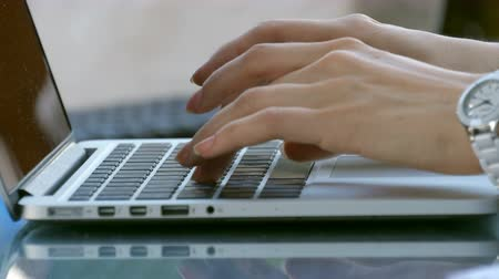 letter board : Typing female hands on keyboard. Woman work outside in cafe on laptop Stock Footage