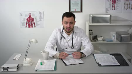 seriously : Doctor seriously explaining to camera