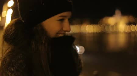 lights up : Smileing woman at winter evening dunai embankment