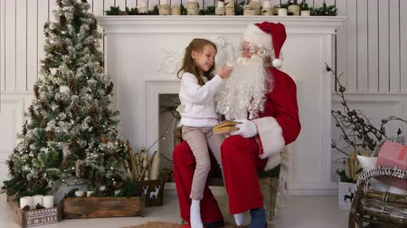 pull out : Surprised little girl checking upon Santa beard