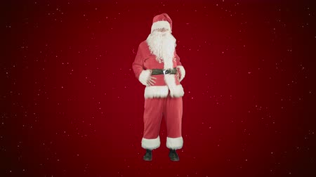 botas : Happy Christmas Santa Claus having fun and dancing on red background with snow Stock Footage