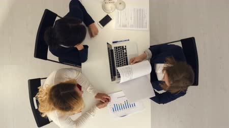 conference table : Young pretty business women working in conference room with documents Stock Footage
