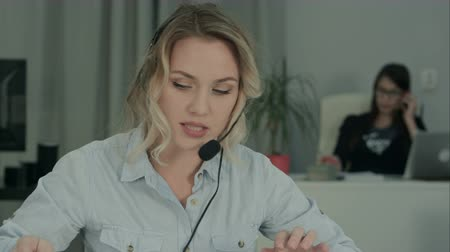 latinamerican : Call center specialist multitasking at work Stock Footage