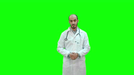 facetime : Serious male doctor talking to the camera on a Green Screen, Chroma Key. Stock Footage