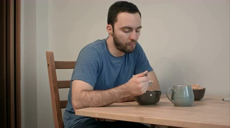 apetite : Young man having no appetite for his breakfast