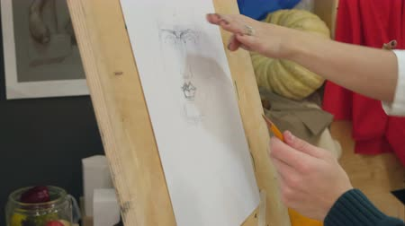 biust : Young man learning to draw classical portrait in studio