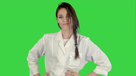 buta : Smiling young woman in lab coat making funny dance on a Green Screen, Chroma Key