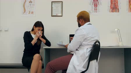 coughing : Sneezing sick female patient listening to the doctor making notes Stock Footage