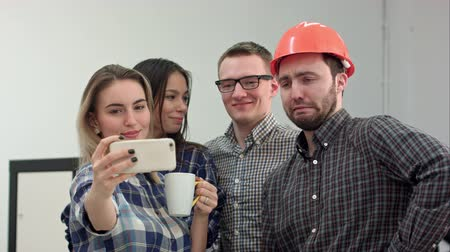 экипаж : Happy young architects taking funny selfies in office Стоковые видеозаписи