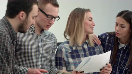 maquette : Cheerful team of engineers working together in architect studio Stock Footage